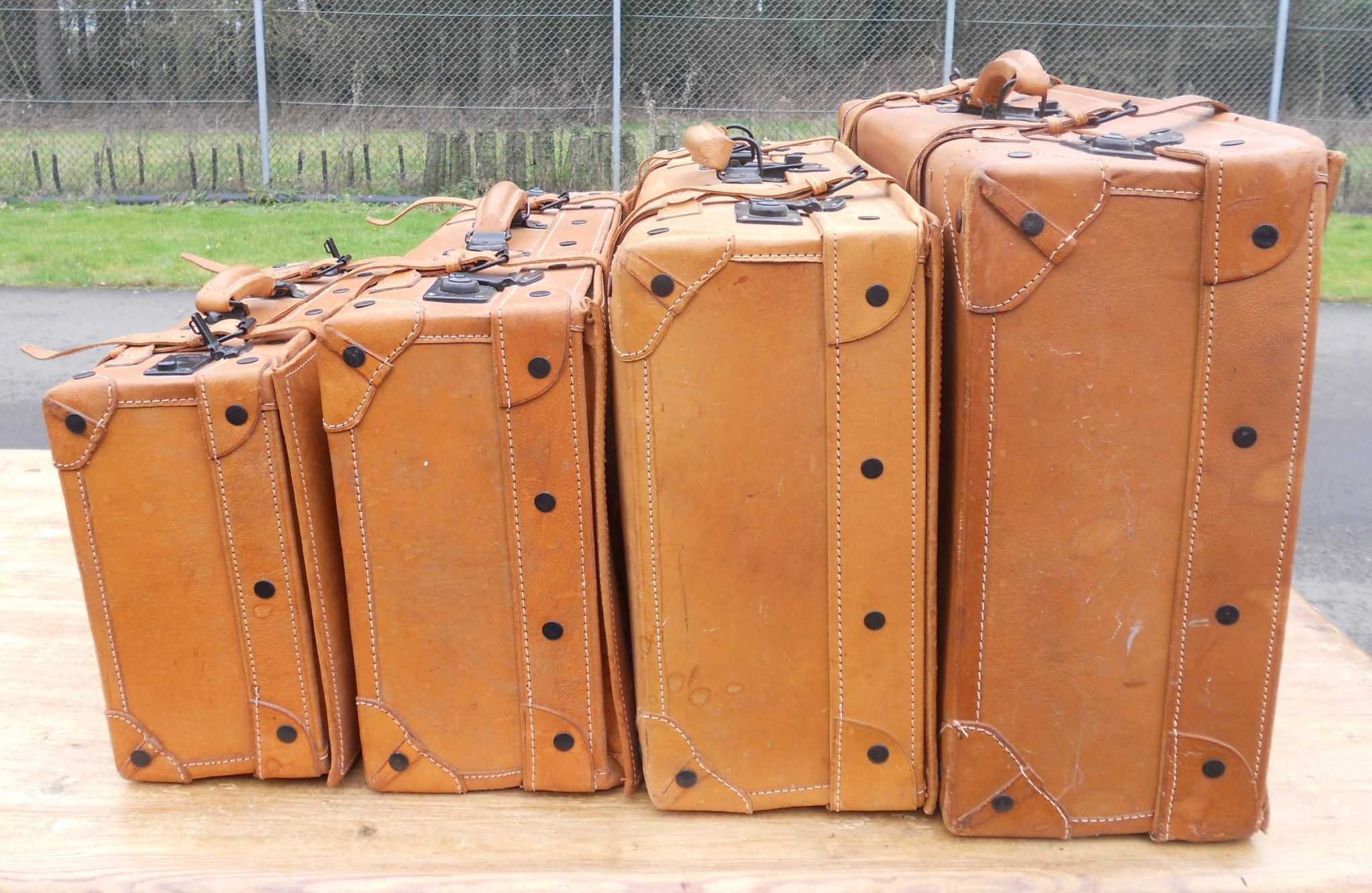 of Four Leather Suitcases by Giovanni